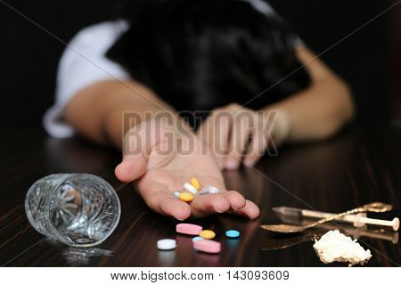 Women alcohol Drug addiction overdose on pills and heroin