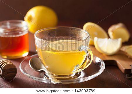 hot lemon ginger honey tea in glass cup