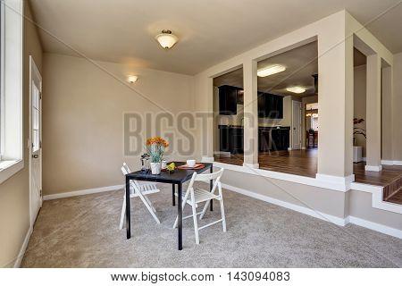 Open Floor Plan Dining Area With Carpet Floor