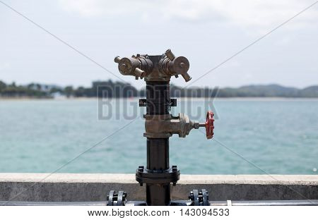 Stand pipe fire hydrant at boat pier for emergency