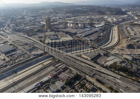 Los Angeles, California, USA - August 6, 2016:  Aerial view of the LA river, summer smog and the Hollywood 101 Freeway.