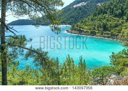 Summer vacation background Saliara aka Marble Beach bay aerial view with turquoise water and pine trees in Thasos Island, Greece