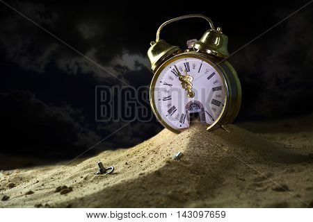 sand running down from the door of a alarm clock in a fantasy desert at night surreal metaphor concept of time goes by insomnia or infinity selected focus narrow depth of field