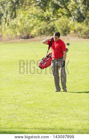 Golfer In Sunlight