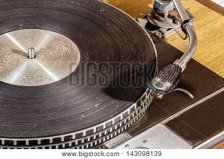 Close Up Vintage Grungy Record Playing Turn Table