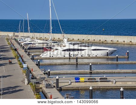 BARCELONA SPAIN - JULY 3 2016: Luxury yachts moored at the harbor