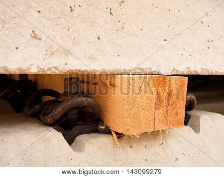Wooden Beam As Separator For Safety Manipulation By Forklift.  Concrete Railway Ties
