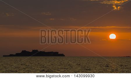 Sunset over Nagasaki, Japan with Hashima Island, also known as Gunkanjima (battleship island) in the background.