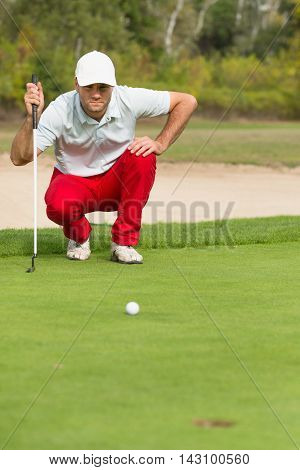 Golfer reading the green, toned image, vertical image