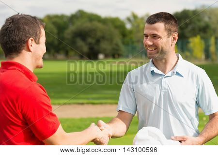 Golfers congratulating after the game, toned image