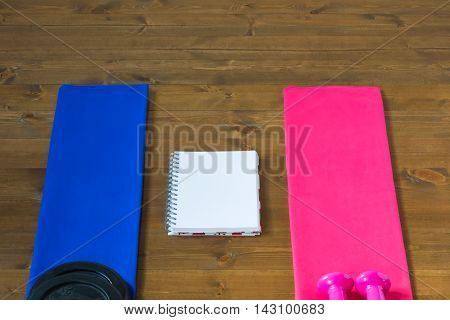 two towels and a notebook to compare the results
