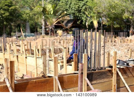 Unidentified builder working on construction site in Thailand
