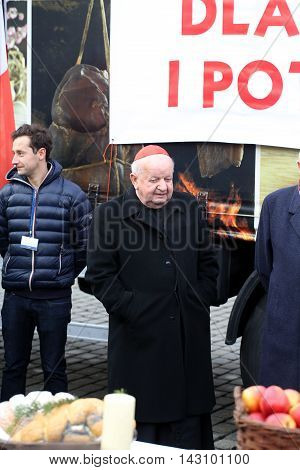 CRACOW POLAND - DECEMBER 20 2015: Cardinal Stanislaw Dziwisz during Christmas Eve for poor and homeless on the Central Market in Cracow.