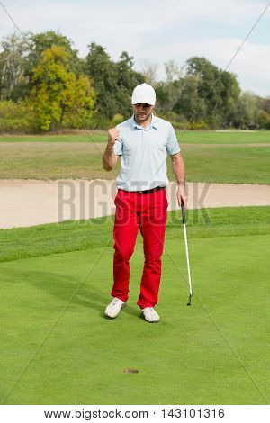 Satisfied Golfer After Successful Putting Shot