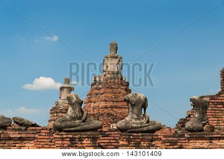 The remains of The old Buddha statue in Wat Chaiwatthanaram Thailand.