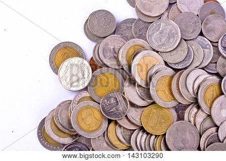 a pile of bath coins on white background finance business isolated
