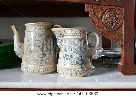old English tea from ceramics in a Liberty wooden furniture with marble top