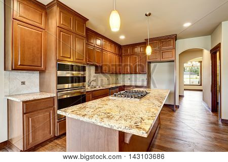 Kitchen Room Interior With Wooden Cabinets With Granite Counter Top