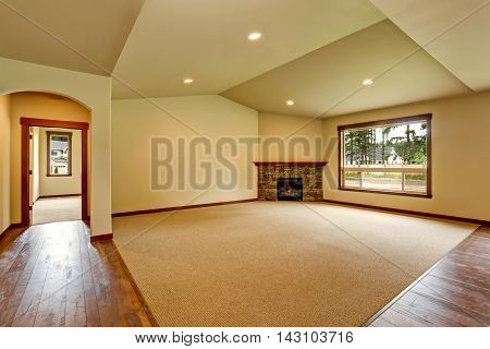 Empty Living Room With Fireplace. Connected To Kitchen Area.