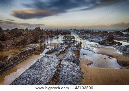 beach sunrise sea beauty reflex landscape rock