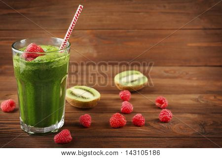 Tasty smoothie drink with fruits on table