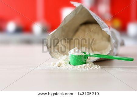 Baby milk formula on kitchen background