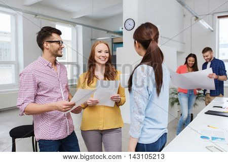 business, communication, startup and people concept - happy multiracial creative team or students on coffee break talking at office