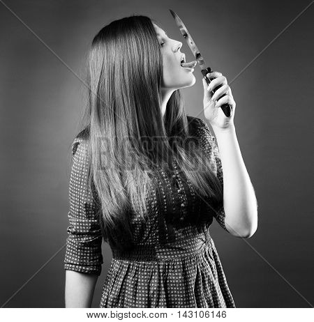 Beautiful Young Girl Holding A Knife On Her Lips