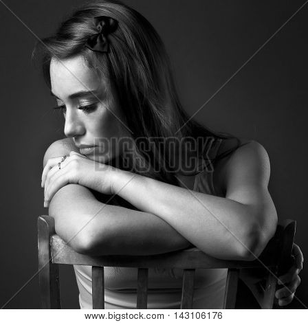 beautiful girl with a melancholy on dark background