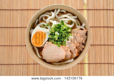 Japanese noodles Udon with chicken and boiled egg in soybean paste (Miso) soup on a mat