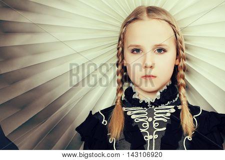 Young beautiful girl with braids fashion portrait