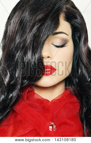 Woman with long black hair and red lips makeup