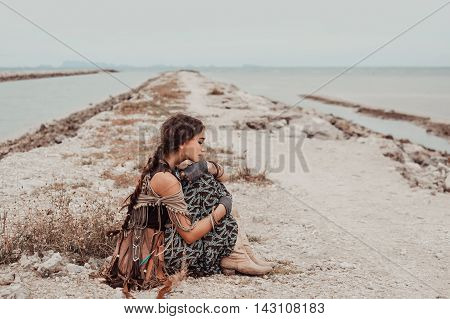 attractive boho woman sitting on pier. Five minutes before storm