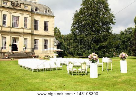 The chairs are ready for a weding ceremony at the