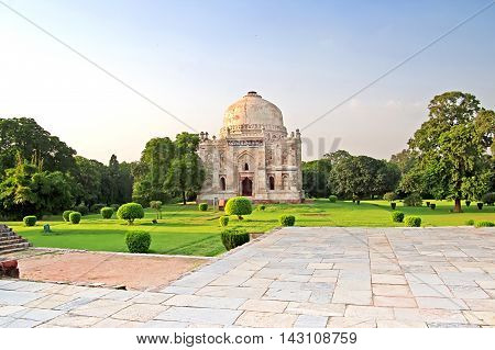 Lodi Gardens on the sunset. Islamic Tomb (Seesh Gumbad) set in landscaped gardens. 15th Century AD. New Delhi, India