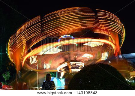 Carousel in amusement Park, night scene long exposure.