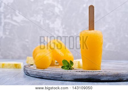 Homemade ice lolly of melon on a light background. Selective focus.