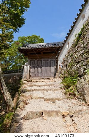 TAKAHASHI JAPAN - JULY 20 2016: East Gate of main bailey (honmaru) of Bitchu Matsuyama castle (17th c.) Takahashi Japan. Matsuyama is one of only 12 survived castles in Japan