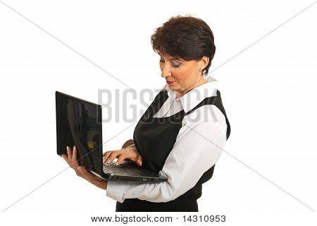 Mature Business Woman Using Laptop