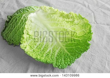 Savoy cabbage leaves on light background