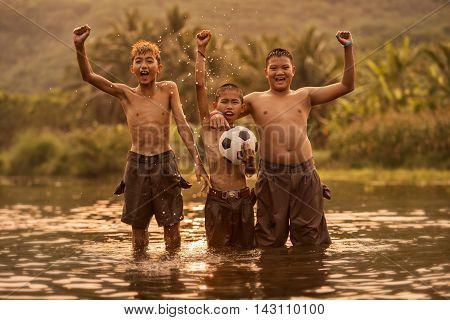 Boy kicking a soccer ball, Play ball