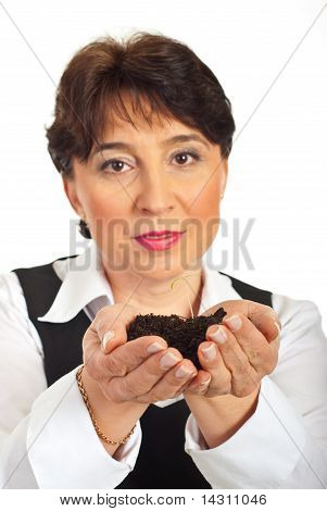 Woman Holding New Plant Life