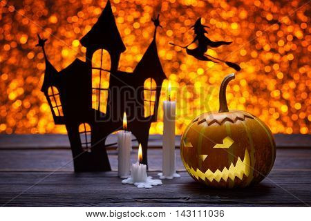 Pumpkin for Halloween, lamp pumpkin, antique wood, silhouette of a witch flying on a broom, celebrate halloween, smiley on a pumpkin, paraffin candles, silhouette of the castle