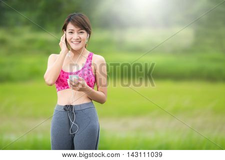 Exercise healthy young woman smiling and listening to music.