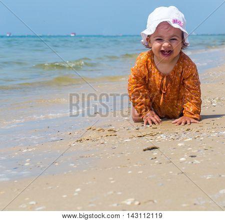 Pretty Little Girl Crawling On The Beach, The Joyful Child, Emotions