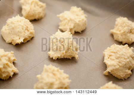 Raw scones dough on baking paper in the kitchen