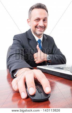 Smiling Businessman Working On Laptop
