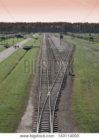 Aerial view of train station with platform in Auschwitz - Birkenau, or Oswiecim - Brzezinka, concentration camp, Poland