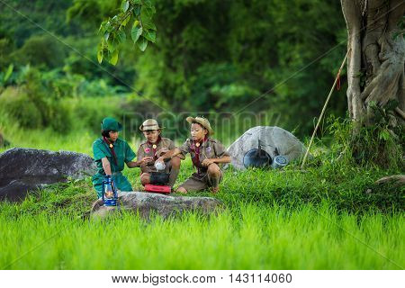 Boy Scout and girl scout in Camp to help themselves to the food as part of the study.