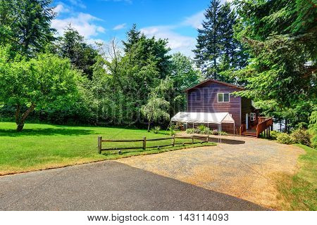 Backyard House With Wooden Trim And Marquee, Well Kept Lawn
